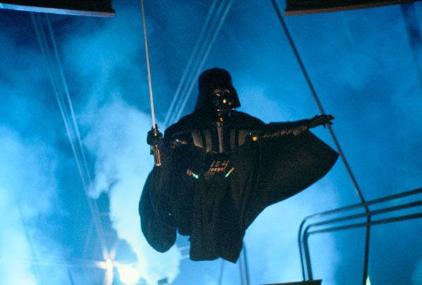 Darth Vader leaps into the air during his lightsaber duel with Luke Skywalker in this behind-the-scenes shot from THE EMPIRE STRIKES BACK.