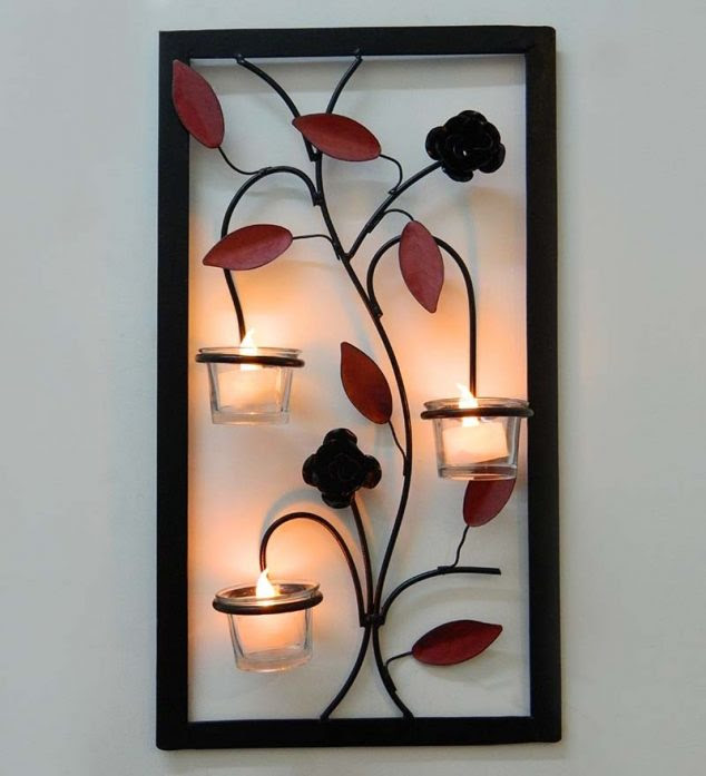 tu casa leaf wall hanging candle holder with wx candle tu casa leaf wall hanging candle holder with zonzmm 634x697 15 Chic Wrought Iron Wall Candle Holders You Will Admire