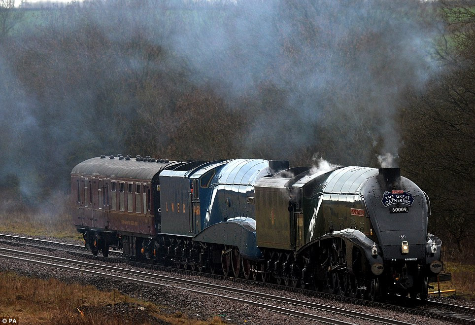 Full steam ahead: The record-breaking Mallard train gets a tow from her sister locomotive Union of South Africa to the National Railway Museum in Shilton