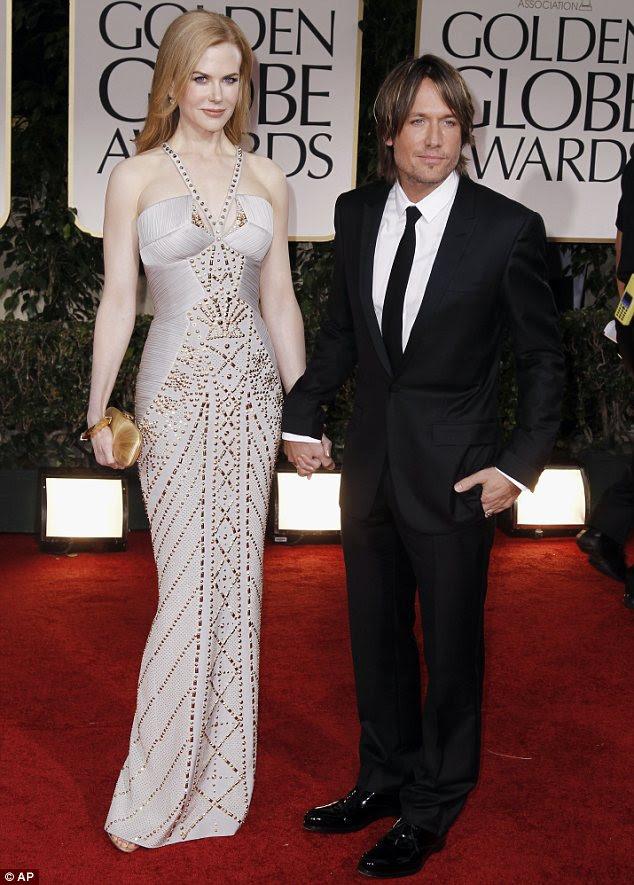 Eu e meu homem: Nicole andou no tapete rd com o melhor acessório do marido Keith Urban