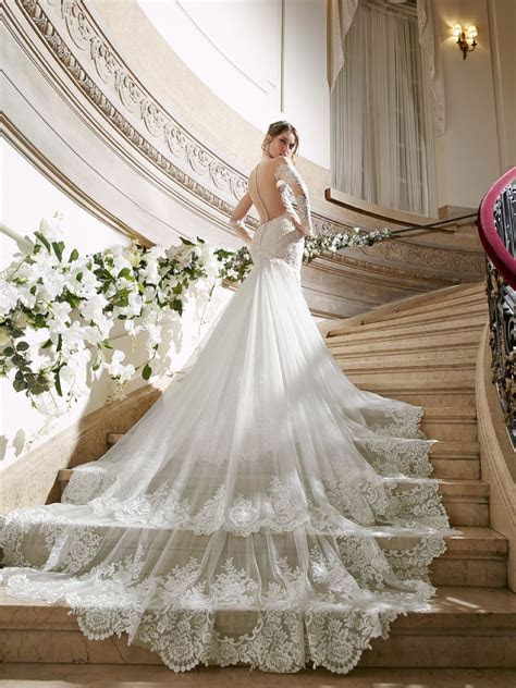 A dreamy fitted wedding dress with lace long sleeve, low
