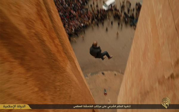 Second man midway down to the ground  as large crowd looks on