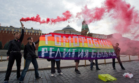 Gay rights activists hold a banner saying