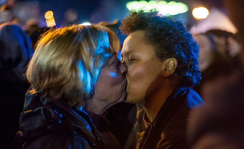 New year affection: Two women embraced and kissed as the clock struck midnight in Cardiff last night
