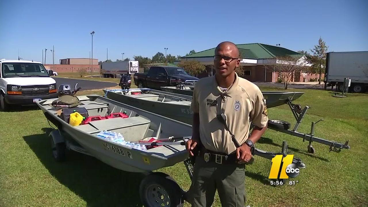 Image result for HIS OWN HOME FLOODING, WILDLIFE OFFICER RESCUES OTHERS
