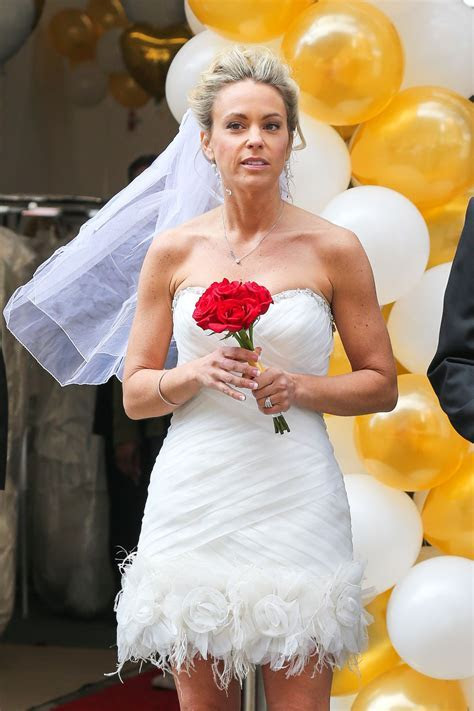 Kate Gosselin Wearing Short Wedding Dress and High Heels