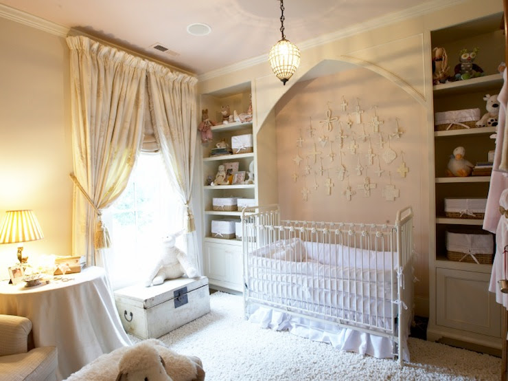nursery design with ivory walls paint color, drapes and plush rug