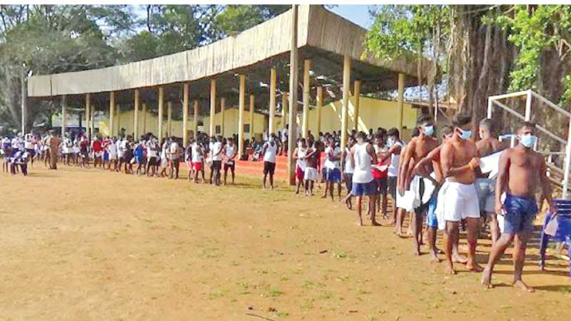 A long line of youth who wish to join the Police, waiting to be interviewed at the Vavuniya Municipal Playgrounds.