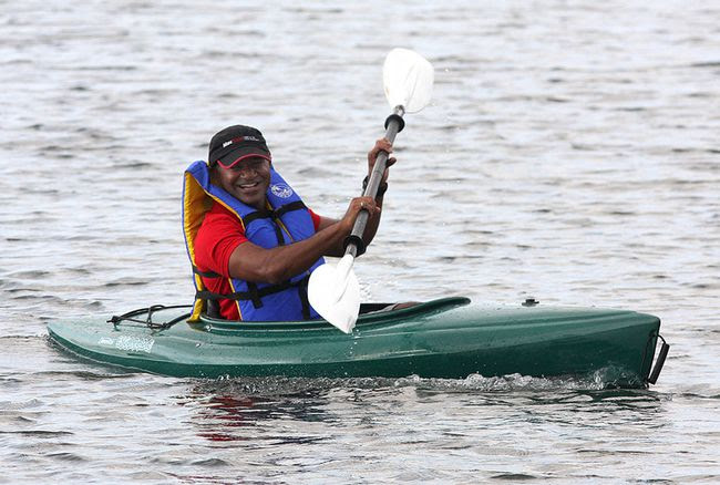 Sushee Perumal, the CEO of MaxSold, kayaks from his home in Barriefield Village on Tuesday to downtown Kingston while the Lasalle Causeway is closed for repairs. (Ian MacAlpine/The Whig-Standard)