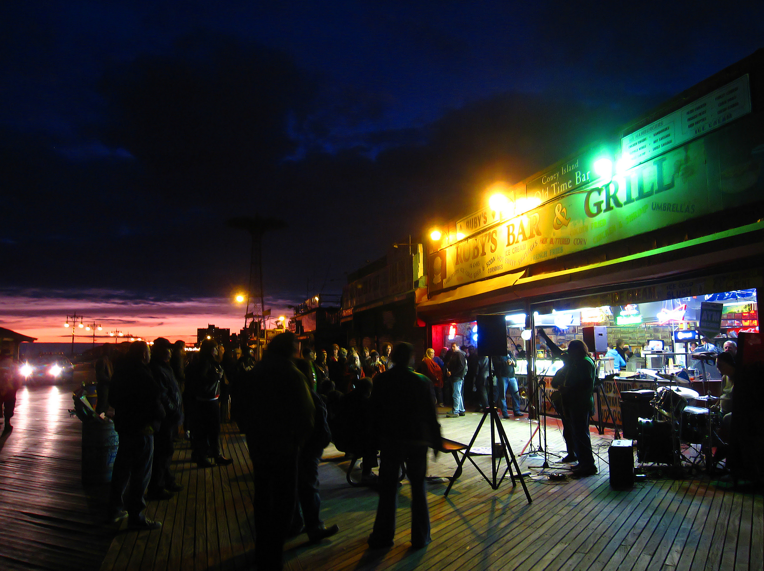 The sun setting over the boardwalk and Ruby's