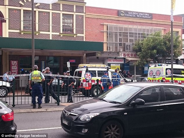 A policeman has been stabbed and his attacker shot dead at a pub in Sydney as shocked Australia Day revellers watched on