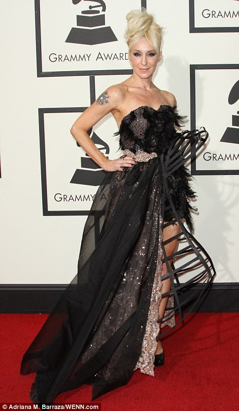 What's going on there?Jes Brieden, 41, had far too many additions to this outfit, from the sheer cape over the embellished half gown to the feathered bodice and the strange structure protruding from one side