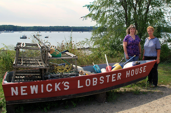 My cousins Amy and Robin posing besides Newick's dinghy.