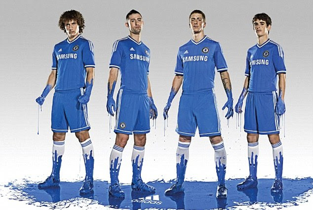 Splash of colour: Chelsea stars were covered in paint for the release of their home kit