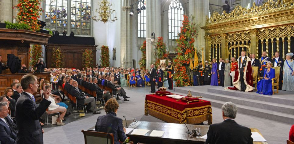 Pledge: King Willem-Alexander, wearing a fur-trimmed ceremonial mantle, swore an oath of allegiance to his country and the constitution