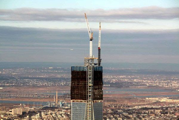 Cranes that will assemble the 1 World Trade Center's (1 WTC) antenna spire are set up on the roof of the skyscraper, on January 11, 2013.