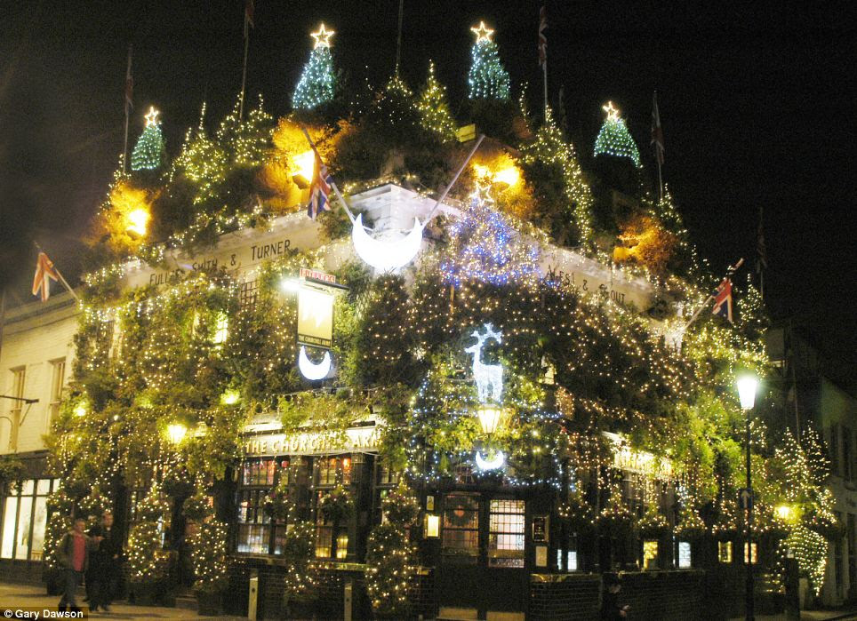 The Churchill Arms in Kensington, London, which has 57 Christmas trees attached to the building, 11,500 lights and 90 hanging flower baskets
