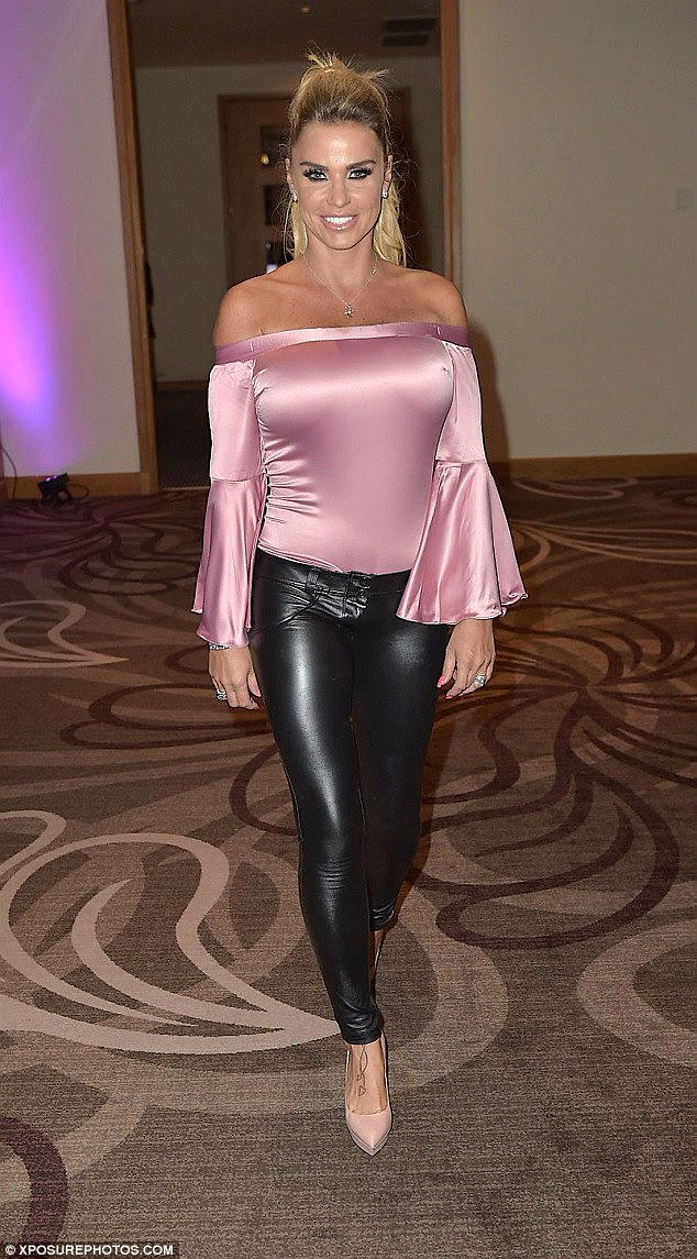 On the promo trail: Katie, 38, put on a glamorous display for an Evening With event at the Hilton, Gateshead, on Monday wearing a figure-hugging, pink satin Bardot top