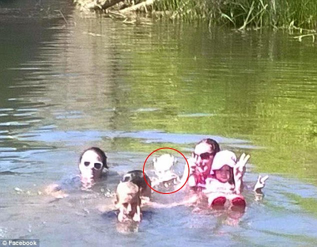Social media users are claiming that the white shape at the back of the image, circled, shows a ghostly face