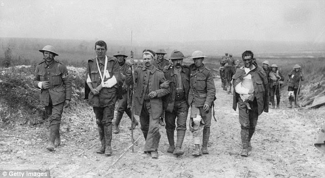 Walking wounded: British soldiers walking back from the front line to receive treatment