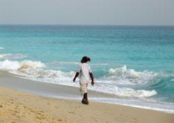 A Man strolls on the Lagos Bar Beach.
