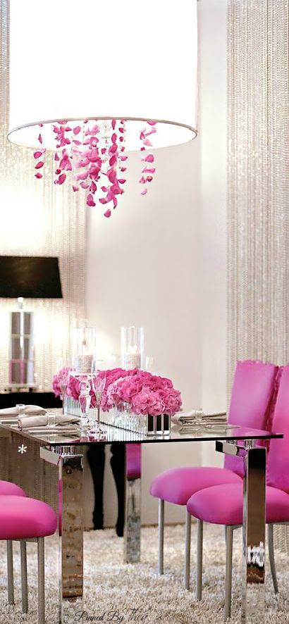 "Hot pink dining chairs and chrome table. Love the chandelier's pink ""crystals"" and drum shade."