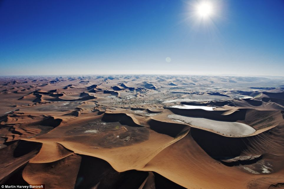 Blazing heat: The sun beats down on the sand dunes of Sossusvlei in the Namib Desert in this aerial shot