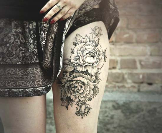Left Thigh Black And White Flowers Tattoo