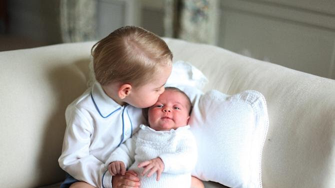 Picture released by Kensington Palace and taken by Britain's Catherine, Duchess of Cambridge in May, 2015 shows Prince George of Cambridge (L) with his sister Princess Charlotte of Cambridge at Anmer Hall in Norfolk, eastern England