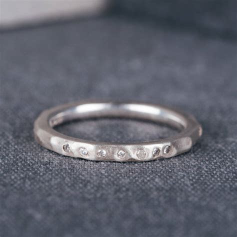 9ct white gold hammered wedding ring with diamonds by
