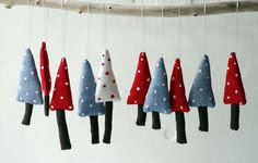 Holiday ornaments. A set of 3 Christmas trees. Blue, red, white.