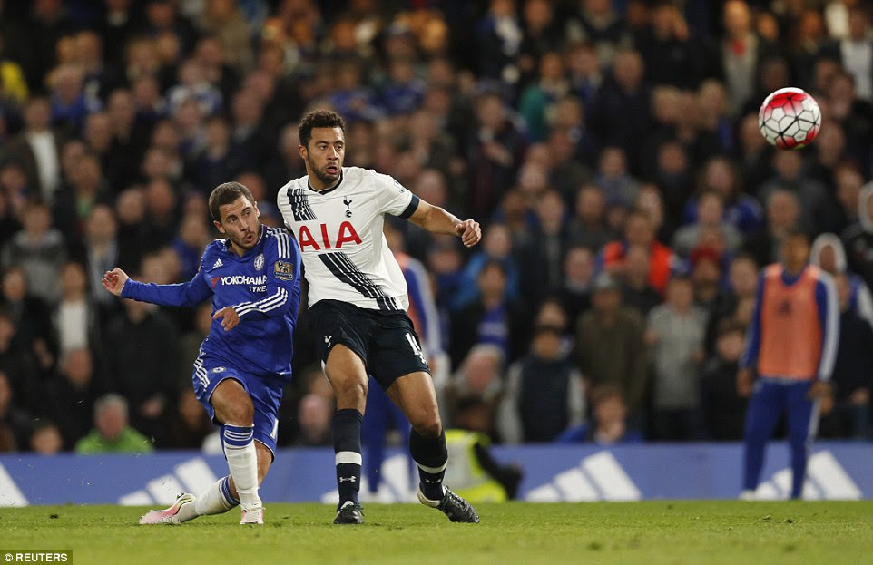 Eden Hazard (left) unleashes a powerful effort on the edge of the goal to level the derby with minutes remaining at Stamford Bridge