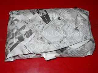fish wrapped in newspaper Pictures, Images and Photos