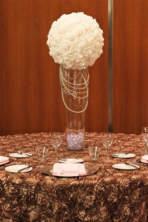 Mocha rosette table cloth. Tall rose ball centerpiece with