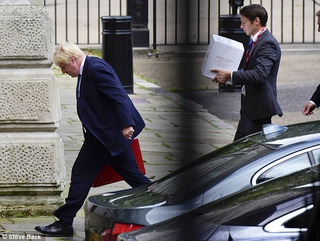 Boris Johnson hosted his New Zealand counterpart Murray McCully in London today - and it appears he gave him a warm welcome as he and his aide were spotted walking into his offices with a crate of wine (pictured)