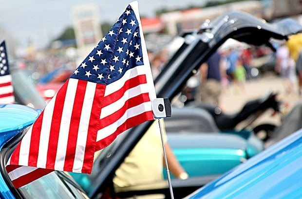 An American flag flies atop a car on display at the Metro Cruise in Wyoming.