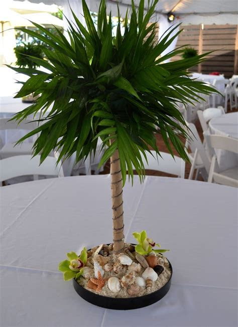 Miniature palm tree centerpiece for beach theme party