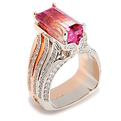 Pink Tourmaline and three diamond band ring.