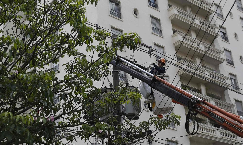 A Sao Paulo technician works on an electrical post during a 30-hour power outage in the Pinheiros neighbourhood.