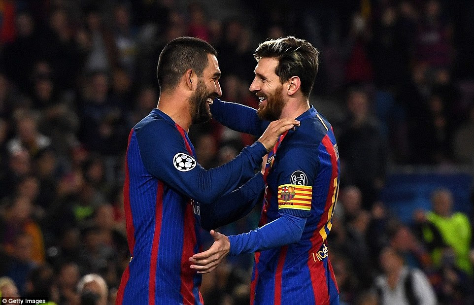 Barca's two triumphant goalscorers Turan and Messi smile and embrace each other after their team's four-star display