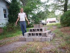 Luca Masters next to his cinderblock pyramid.
