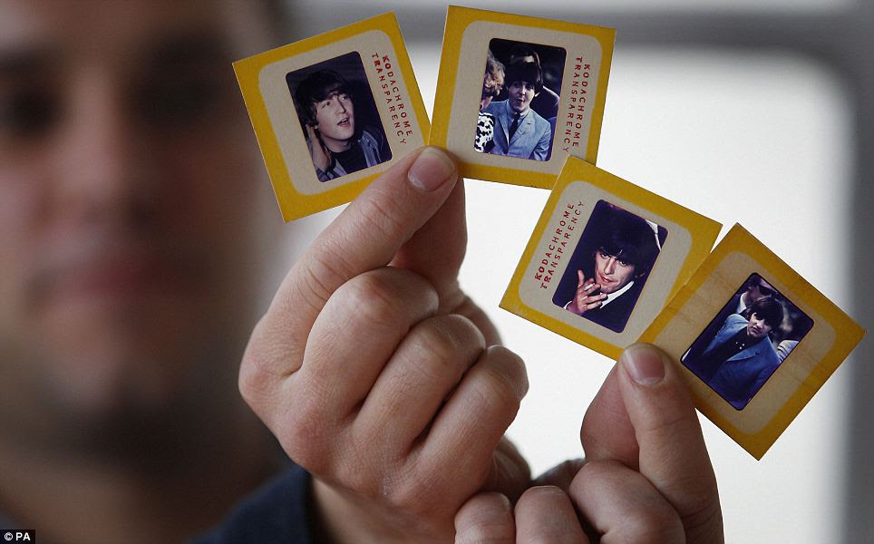 Taking ownership: 65 slides of the photos are going up for auction on March 22