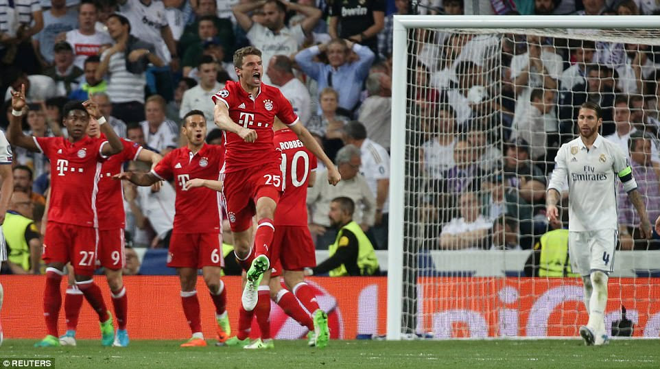 A stony faced Ramos watches on as the Bayern players celebrate the Real defender's moment of misfortune
