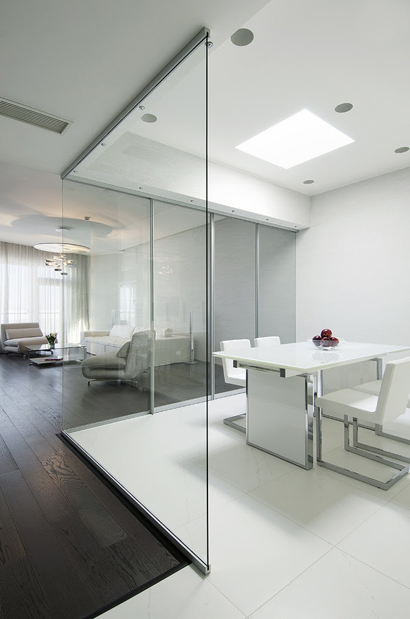 kitchen semi open plan with retractable glass walls and large white floor tiles