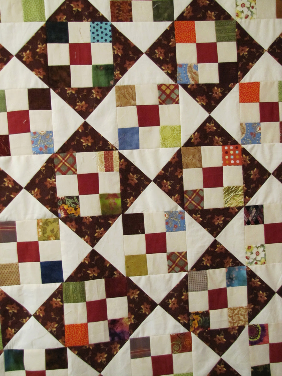 brown and rust drag-along-quilt