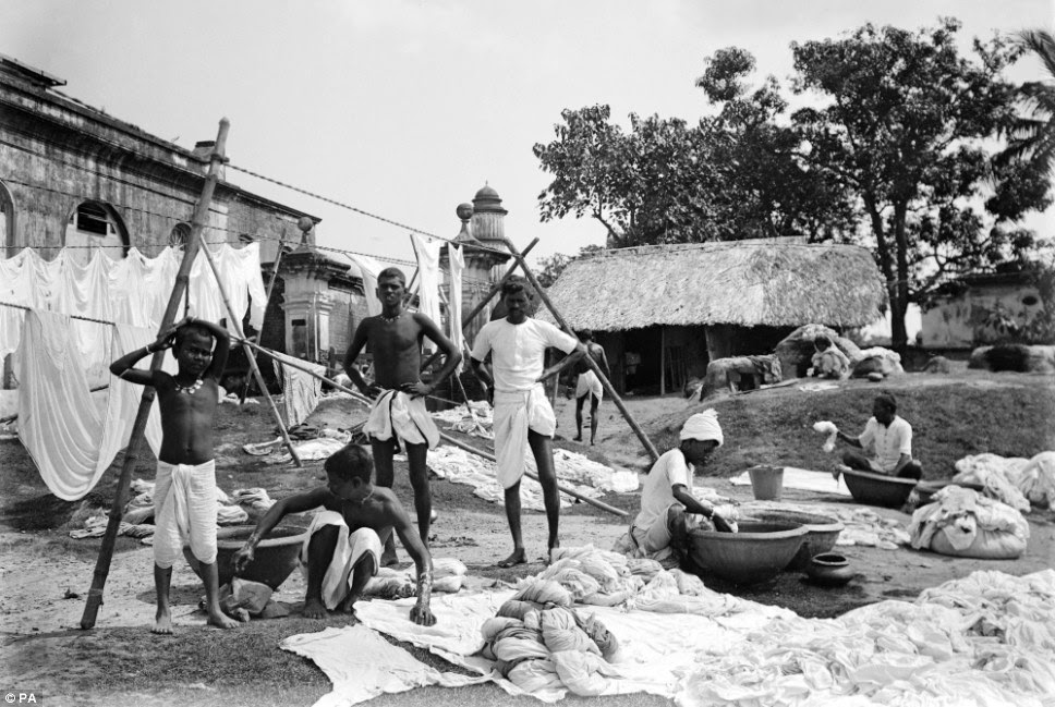 Waterside with a group of washermen at a dhobi ghat (open-air laundry zone)