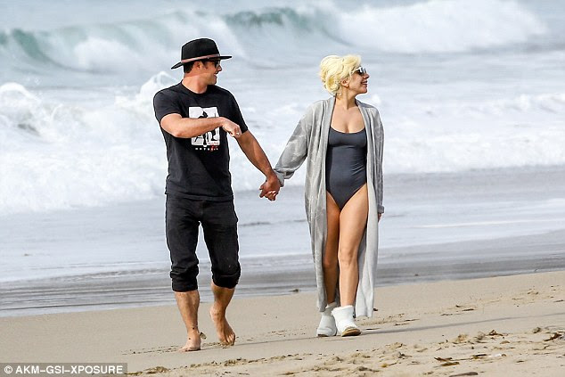 Rest and relaxation: Walking along the sand near her home with her husband-to-be, the star could not have looked more relaxed which was in contrast to how she appeared during the awards