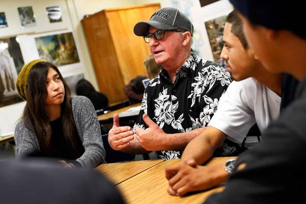 A.J. Duffy, center, with students Emily Cedeno, Jesse Chavez and others