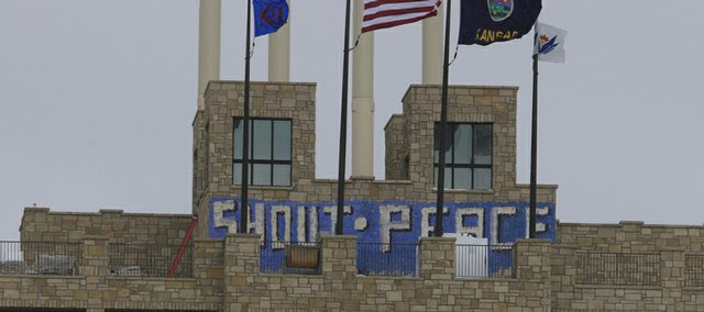"""Vandals painted """"shout"""" and """"peace"""" on the south side of The Oread's top viewing deck over the weekend."""