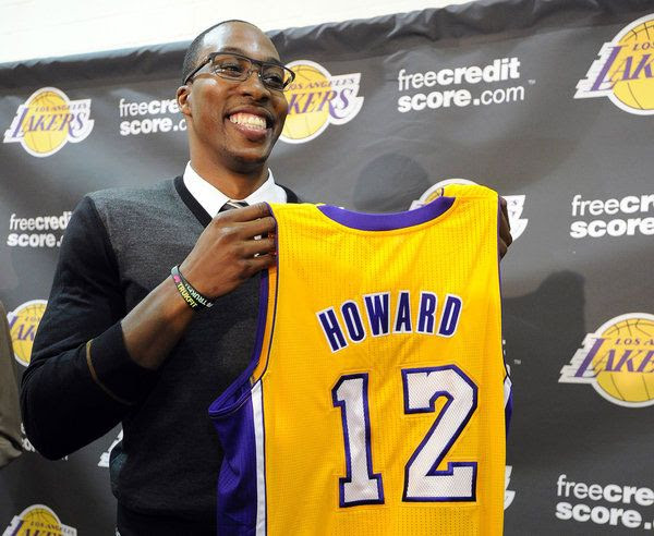 Dwight Howard presents the jersey that he's going to wear this upcoming NBA season.